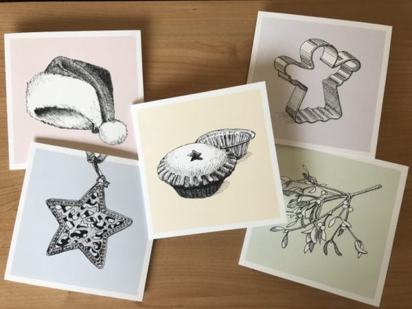 Image of 5 Christmas cards - hand-sketched drawings on each including a Christmas hat, bauble, mince pie, mistletoe and angel.